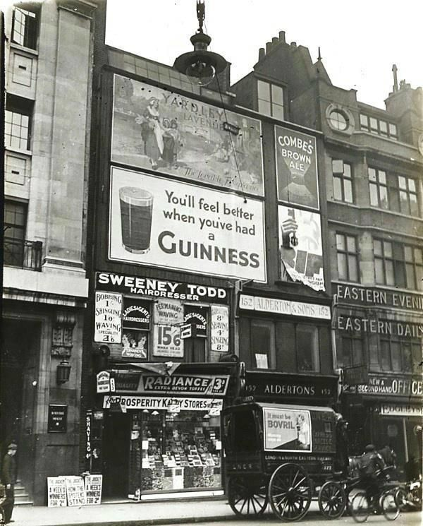 Sweeny Todd Barbers #Fleetstreet c.1930 with old Guinness poster and other poster advertisements