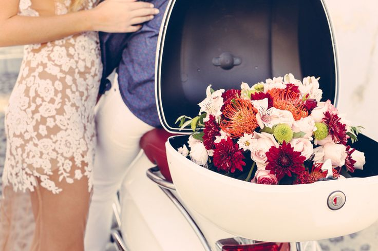Bouquet in the Vespa getaway car during this Santorini, Greece elopement.  Photo by Leanna Flecky.