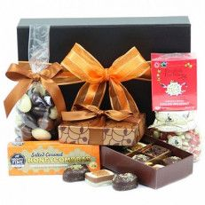 Chocolate Zest Hamper This Small And Elegant Gift Hamper Can Be A Very Pleasant Gift For Anyone. The Hamper Is Assembled With Savory Treats Of Rosey Apples Sweet Jar, Belgian Chocolates, Chocolate Coated Almonds And Some Refreshing Tea To Compliment With#UK