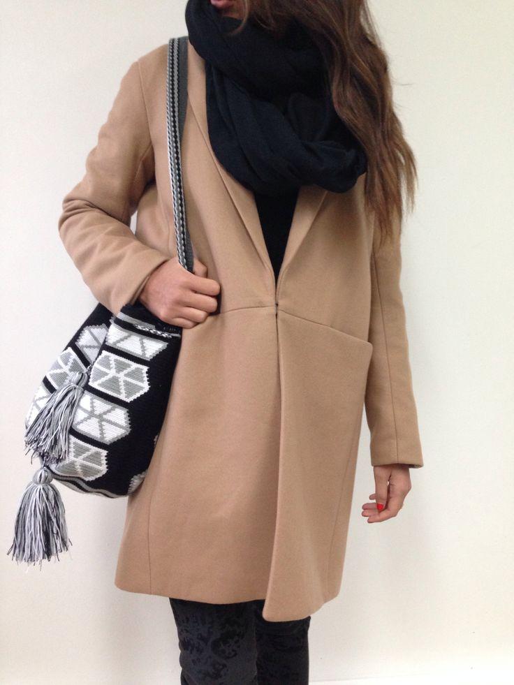 Camel coat and black mochila