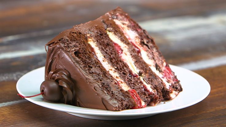 Devil's food cake layers enriched with milk chocolate and a trio of extracts are sandwiched with the simplest and most decadent stuffing...