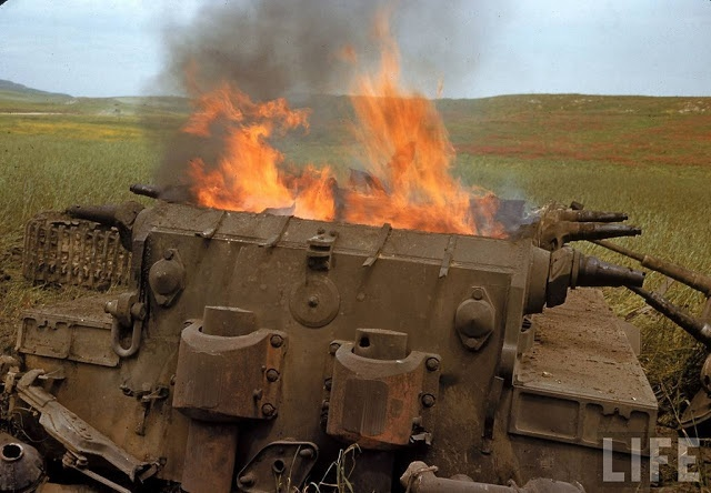North African Campaign, a knocked out German Tiger 1 still burning. 1943.
