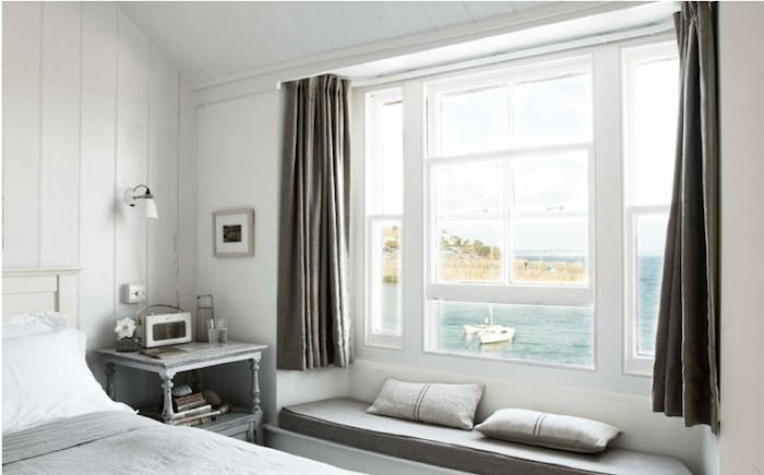 The bedroom overlooks the picturesque harbor.