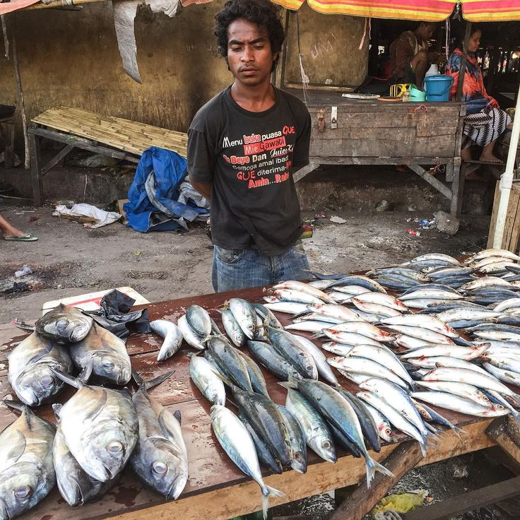 """""""Traditional Buginese fisherman was selling his fishes at Paotere fish market in Makassar. In honor of World Food Day, respect traditional fishermen that…"""""""