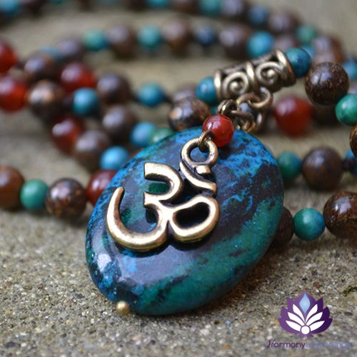 Our Om necklace has been designed combining Chrysocolla, Bronzite and Carnelian. This necklace is the perfect companion to our Om bracelet and they look wonderful worn together. Created to help you feel empowered, peaceful and positively re-energized. Each Gemstone helps to balance key energy centres in your body.  Finished with a high quality TierraCast Om Charm (silver or bronze) that lays ...