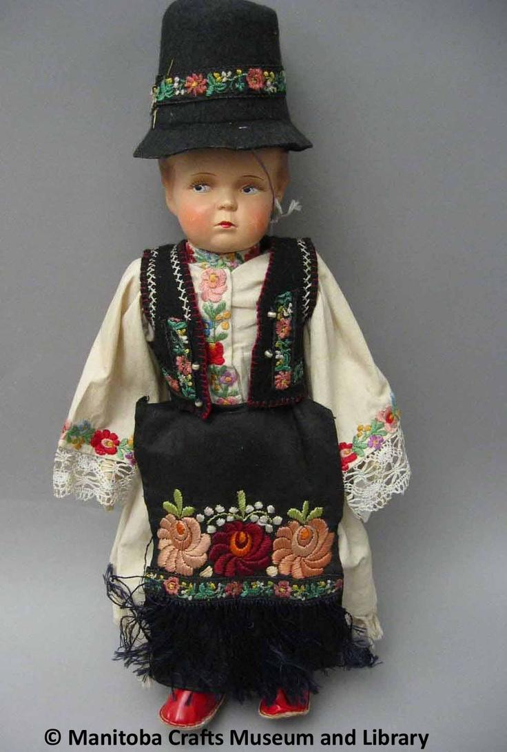 Artist: Matyo Mazokovest  Hungarian doll and hat.