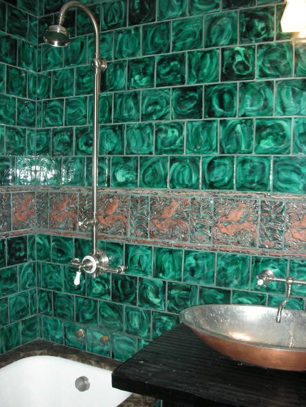 Handmade green-glazed tile bathroom: This bathroom has handmade, green-glazed tiles and copper faucets.  It has a rich palette, and is an unusual combination for a bathroom.  Everything in the whole room is custom-made, which brings it to a certain level of luxury that my clients have come to expect from me. From HGTVRemodels.com
