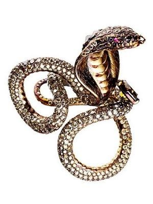 Serpent ring by Wallace Chan; here, the cobra is a symbol of protection.