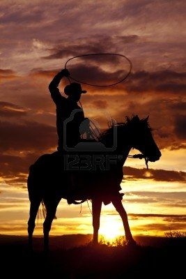 A Cowboy Is Sitting On His Horse In The Sunset And Swinging A.. Royalty Free Stock Photo, Pictures, Images And Stock Photography. Image 15463812.