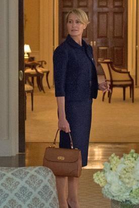Robin Wright wearing Cartier Tank Louis Watch and Ralph Lauren Medium Tiffin Bag