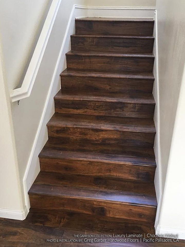 What Is Laminate Wood Flooring unlike this wood floor laminate floors are resistant to stains and damage Chocolate Walnut Laminate Flooring Hardwood Flooring Stairs Staircase