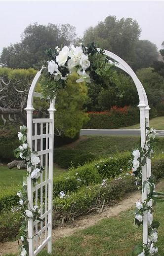 Wedding arch decorations ideas white lattice arch shown for Arch decoration ideas