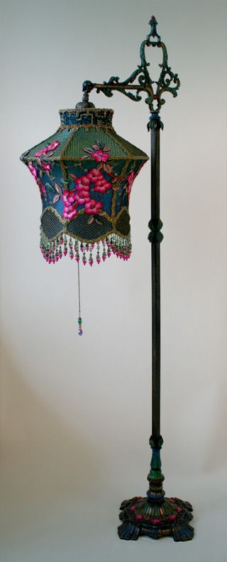 1920s painted bridge lamp holds a Cherry Blossom Lantern shade dyed green to blue and covered in vibrant fuschia colored vintage silk cherry blossom appliques and gold mesh. The bottom is adorned with fancy little flower beads. This shade would also work great hung as a lantern without the base.