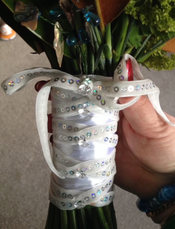 Details of brides ribbon on the stems.