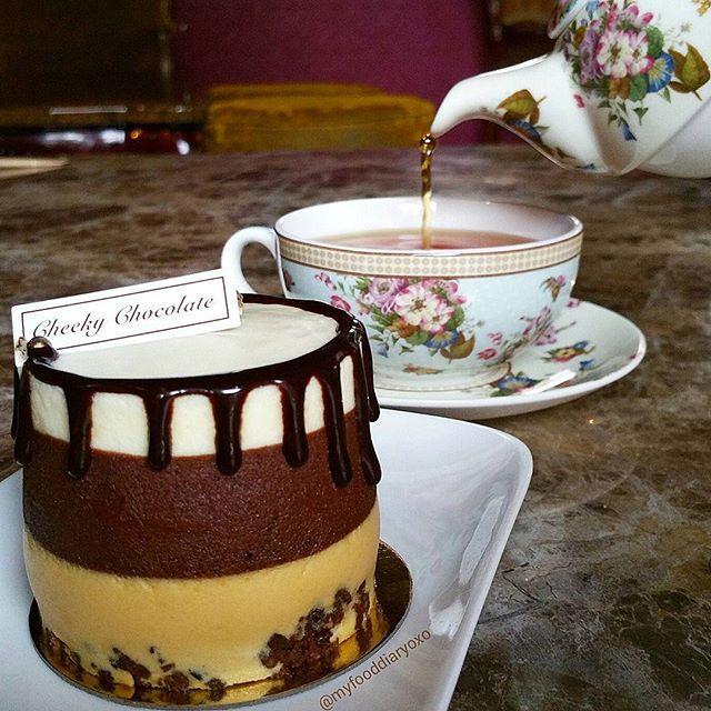 Photo #1125159413021025219 from @myfooddiaryoxo. The Newbie ~ cocoa nib crumbs, choc sponge, salted caramel mousse, dark choc mousse, white choc mousse, salted macaron & caramelised pecan ~ earl grey tea  #earlgreytea #tea #teaset #cake #cakeporn #dessert #dessertinsydney #sweettooth #cheekychocolate #cafe #sydneycafe #sydneyfoodies #sydneyfoodblog #sydneyeats #sydneyfood #foodphotography #foodpics #instafood #foodstagram