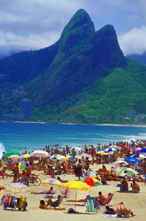 Rio, Brazil - I must go here. Great music, beach life, love of dance, great weather, good food and refreshing cocktails.