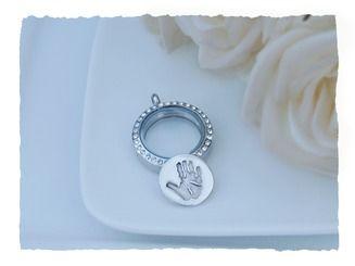 Handprint disc for your floating locket http://www.silverhavenjewellery.com/silver-prints/handprint-footprint-locket-coin/