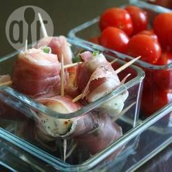 Marinated mozzarella and prosciutto bites   Entertaining is effortless and elegant with a recipe like this... Fresh balls of mozzarella are marinated, then wrapped in prosciutto with a leaf of fresh basil.