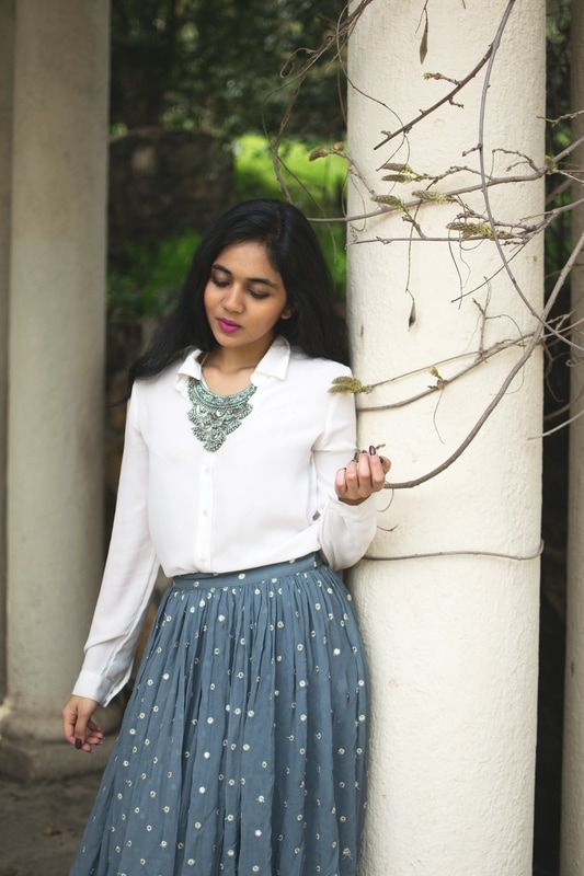 Chunky jewelry on a sheer white shirt is a winning formula. There, I said it!