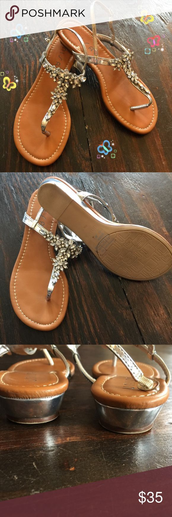 Unisa Silver Jeweled sandals Unisa Jeweled sandals size 7.5. These gorgeous sandals are perfect with jeans, a cute dress or skirt! Casual or fancy they'll go with anything!!! Only worn once! They are in great condition! Unisa Shoes Sandals