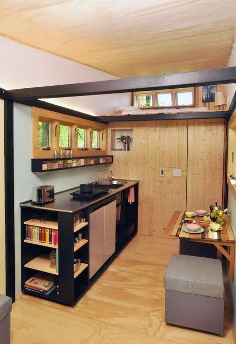 Кухня оснащена кран низкого потока и много пространства столешницы