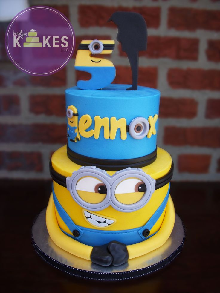 Despicable Me minion cake Cakes are iced in buttercream.  Minions, name, number and Gru are all marshmallow fondant.