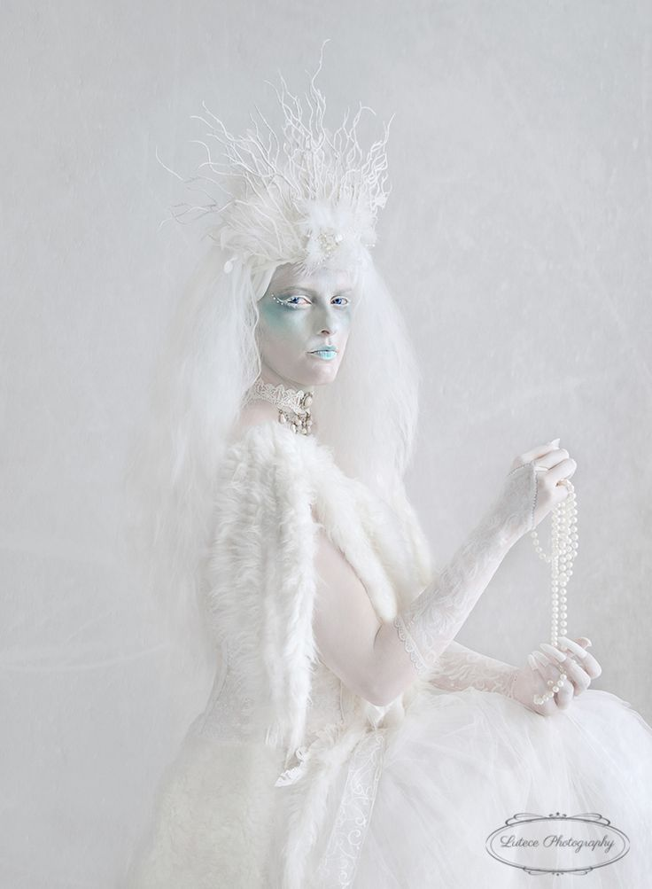 What is she thinking her stare implies an aristocratic feel as she plays with the pearls. http://www.lutecephotography.co.nz/site/#/home/