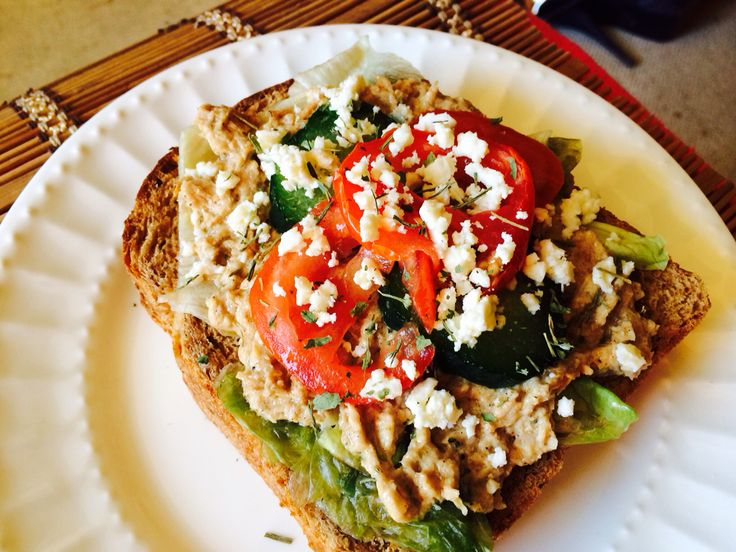 Tuna sandwich Ingredients  Tuna seeped in extra virgin oil Red onion Lemon Black pepper Cayenne paper Mayonnaise Salt Lettuce Any bread if your choice( I used rye bread) Feta cheese Tomatoes  Enjoy.
