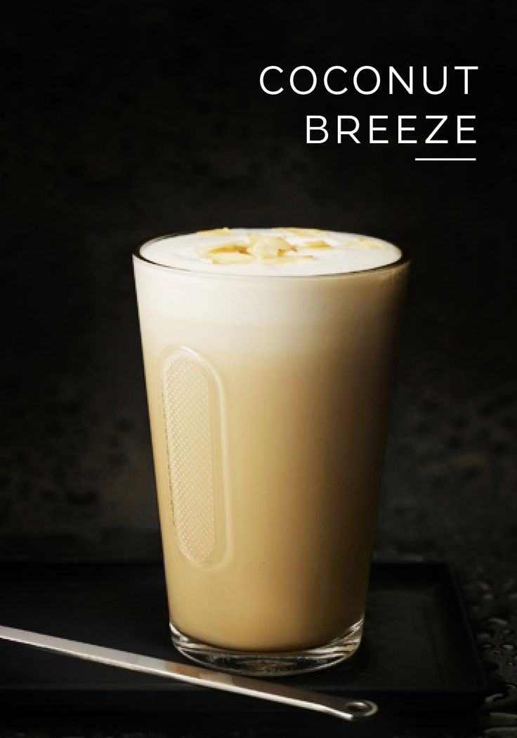 It's not hard to imagine palm trees swaying and the sound of ocean waves crashing along the shore as you sip from this exotic Coconut Breeze coffee. This easy coffee recipe uses Grand Cru Arpeggio, toasted coconut, and vanilla extract to create a tropical coffee drinking experience like no other. Enjoy this indulgent iced coffee recipe as you dream of warmer weather.