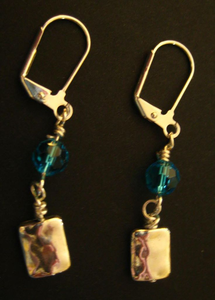 Blue Bicone & Sterling Earrings - Blue bicone stone with silver-plated square drops. Leverback style earring hooks.  $2.99 available at