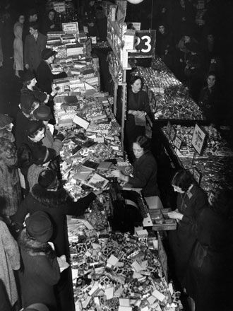 Dec 1937. Christmas shopping in Woolworths, Oxford Street, London.