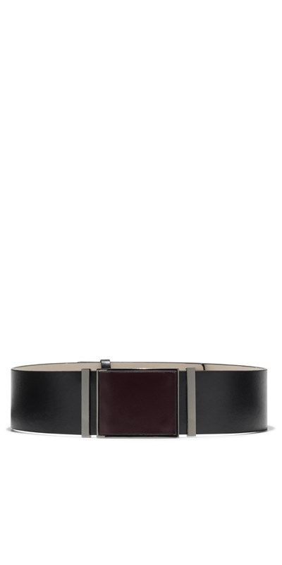 This wide leather waist belt is detailed with a leather covered centre panel, and black nickel metal detail. Fastened at the back with post fittings and a leather keeper. Designed exclusively for Cue by Peter Lang. Made in China.