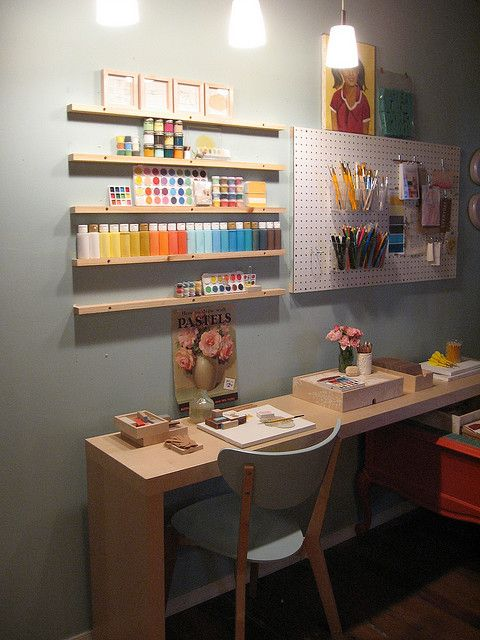 Creative Peg Board Storage and thin shelves for artist supplies like paint