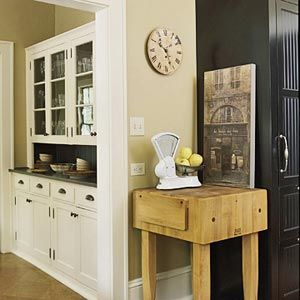 Butcher block table for dead corner. Use as a coffee/breakfast bar and then turn it into a reg bar during dinner parties