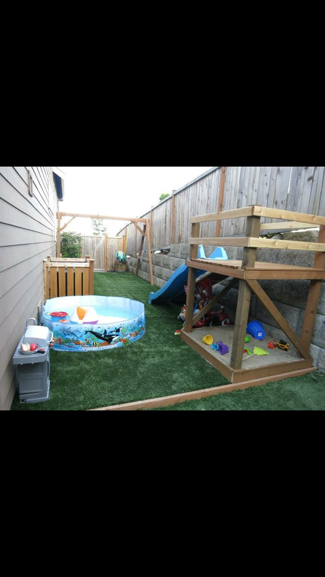 Wasted space side yard turned into kids outdoor play area slide, turf, swing set, sandbox