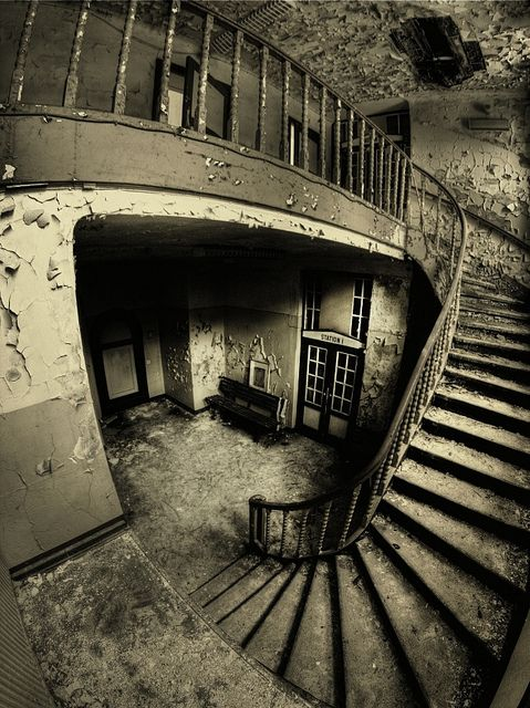 Stairs in an abandoned hospital.  The composition of this image makes it feel very surreal and magical, like you're stepping into another world entirely.