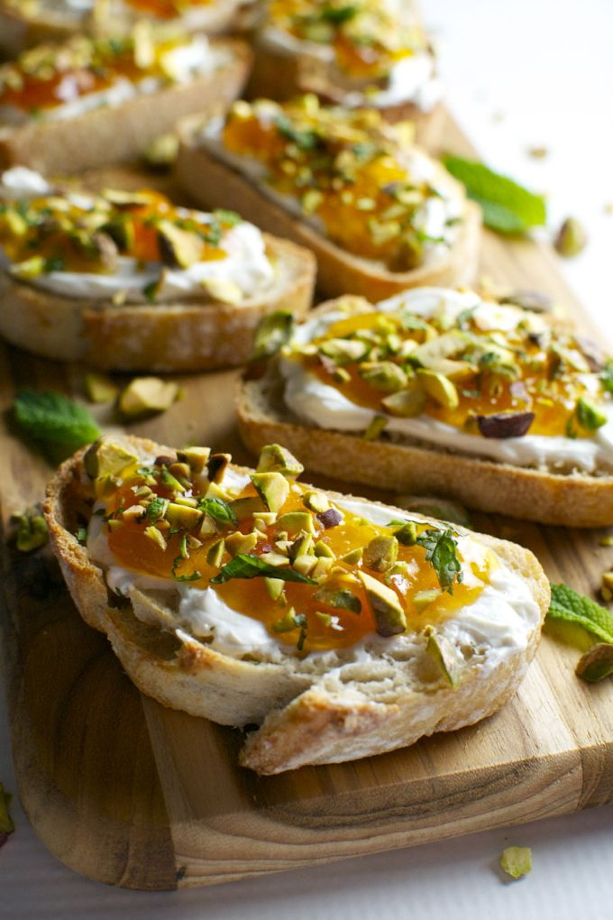 goat cheese apricot crostini wih pistachio and mint. great summer appetizer