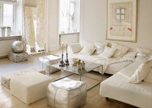white white lounge with sliver accent touches