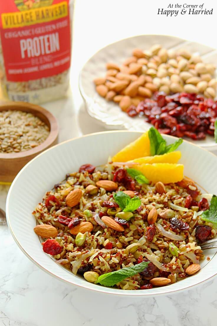 VEGAN PROTEIN-PACKED PERSIAN JEWELLED PILAF - HAPPY&HARRIED. This fragrant Persian Jeweled Pilaf is dotted with cranberries, nuts & saffron, and made with a protein-packed blend of rice, quinoa & lentils. #happyandharried #Persian #Iranian #jeweled #rice #pilaf #gluten #free #vegan #recipe
