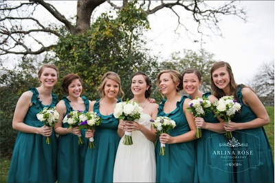 Teal bridesmaid dresses with white/green flowers