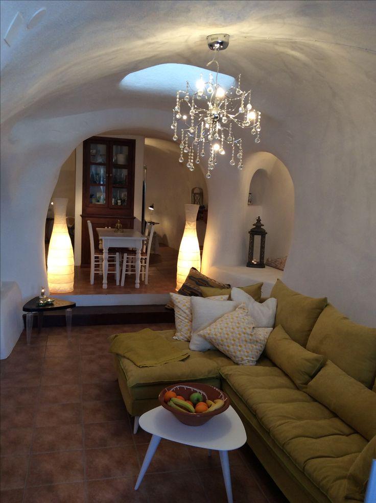 Livingroom with marrocan windtower in cavehouse Hansen Villa Finikkia Santorini