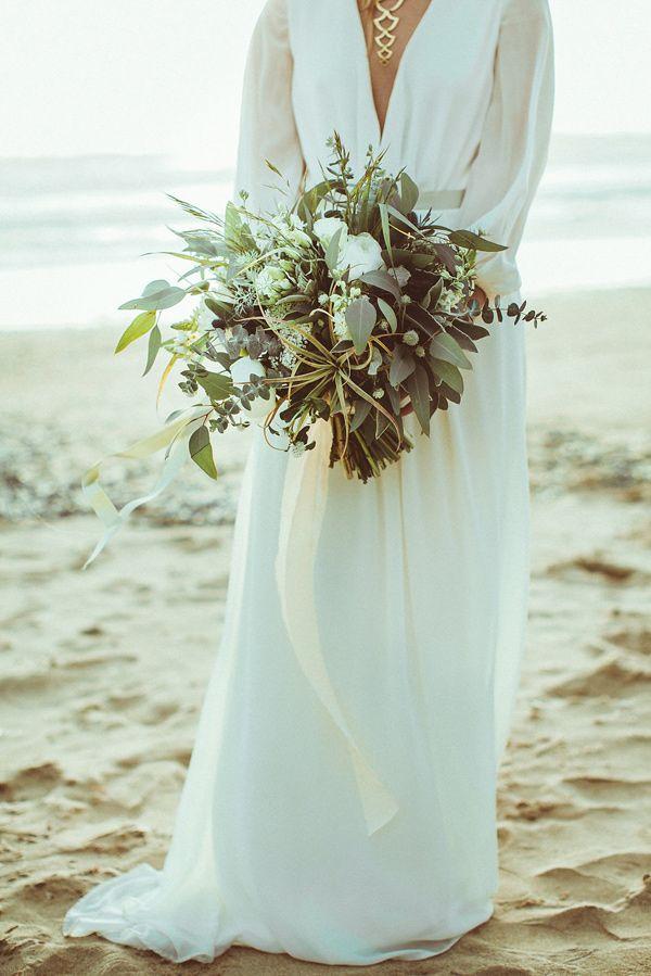 Long sleeved boho wedding dress and wild greenery bouquet. Oregon Beach wedding near Lincoln City. Photo by Hazelwood Photo, published by Ruffled.