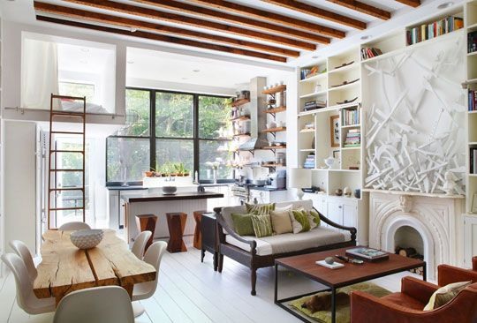 homey and modern at the same time. Love the white floors and the bookshelves.