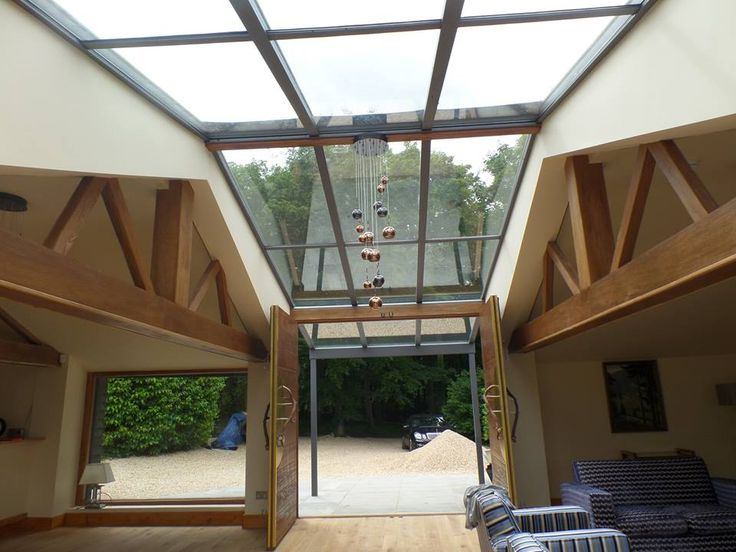 Two run-down barns linked together with this incredible Weinor glass ceiling - Constructed by OpenSpace Living