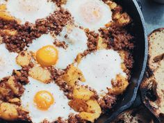Baked Eggs with Chorizo and Potatoes | These baked eggs with chorizo—a hearty combination of crumbled spicy sausage, chunks of crispy potatoes and soft, runny eggs—are great to make for a crowd.
