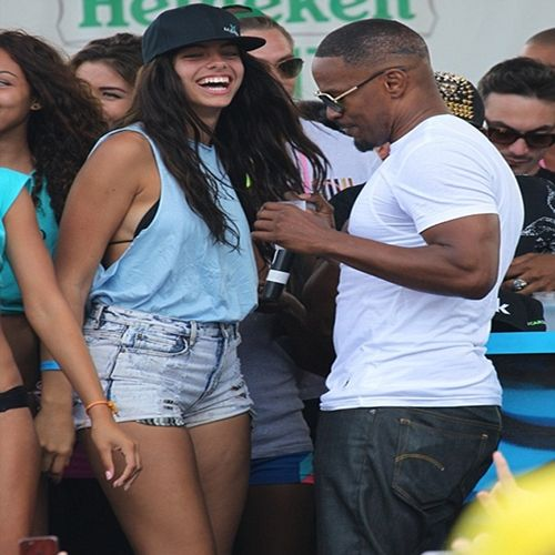 Jamie Foxx Parties It Up With Beach Babes On Miami Beach + John Legend's Wife Chrissy Preps For SI Swimsuit Issue...With Topless IG Video- http://getmybuzzup.com/wp-content/uploads/2014/02/254509-thumb1.jpg- http://getmybuzzup.com/jamie-foxx-parties-beach-babes-miami-beach-john-legends-wife-chrissy-preps-si-swimsuit-issue-topless-ig-video/- By Natasha Jamie Foxx loves a party girl…as he's often seen drinking it up and doing the most with random chicks at some type