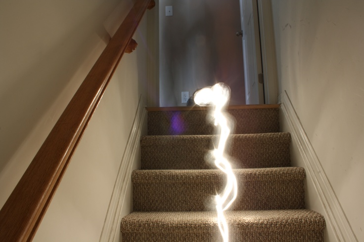 spilling light down the stairs.
