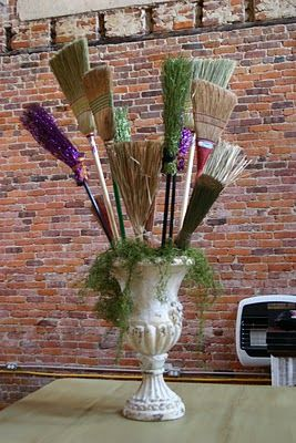 "Have to do this for Halloween!!!--Then put a wooden sign that says ""Broom Parking"" at the bottom of the urn. :)"