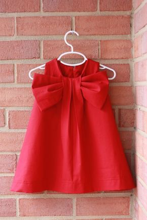 She figured out how to make her own big bow dresses - but is selling the dresses not the pattern!  :)