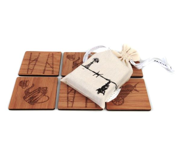 Our beautiful Karoo inspired wooden coasters each have their own intricate Karoo symbol carving and come packaged in a locally made linen draw string bag. #coasters #wood #decor
